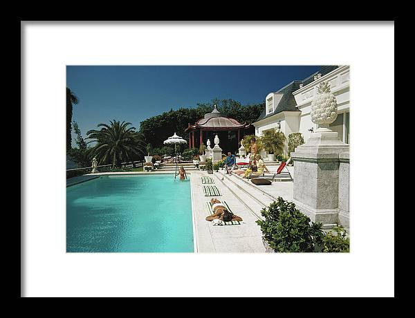 People Framed Print featuring the photograph Poolside Chez Holder by Slim Aarons