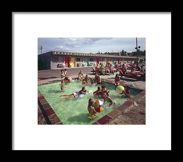 Recreational Pursuit Framed Print featuring the photograph Poolside Fun At Arca Manor by Aladdin Color Inc