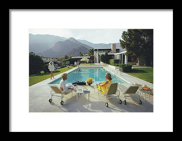 Swimming Pool Framed Print featuring the photograph Poolside Gossip by Slim Aarons