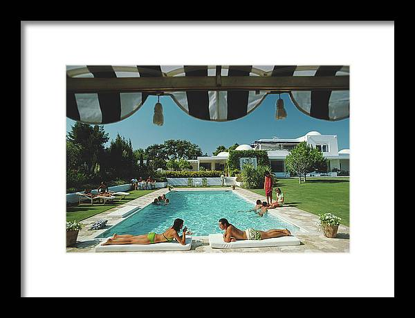 People Framed Print featuring the photograph Poolside In Sotogrande by Slim Aarons