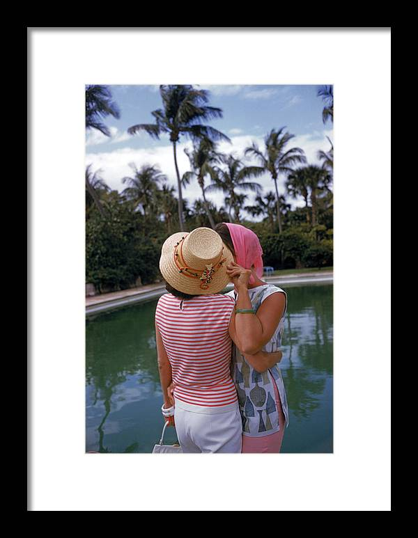 Lilly Pulitzer Framed Print featuring the photograph Poolside Secrets by Slim Aarons