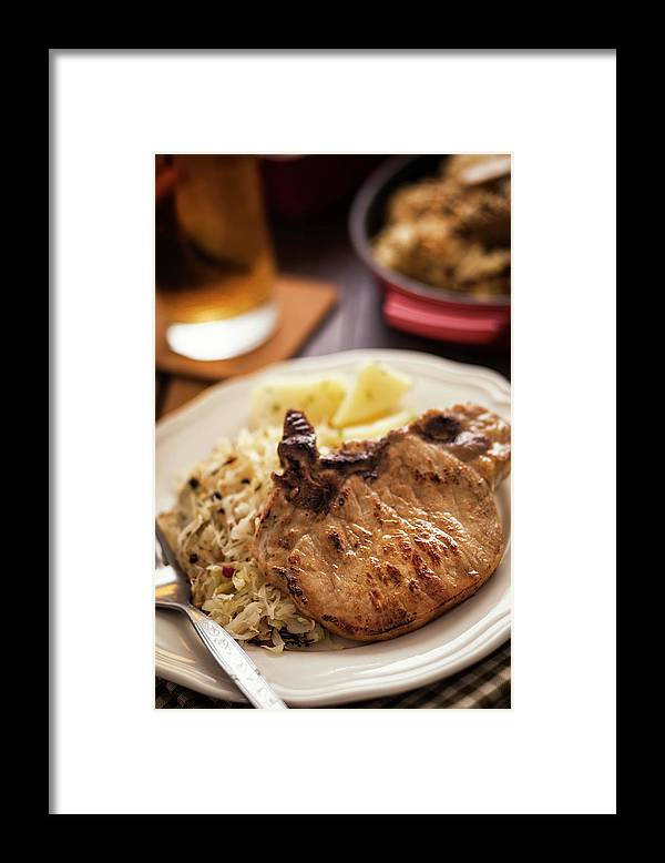 Meat Chop Framed Print featuring the photograph Pork Chop And Sauerkraut by Gmvozd
