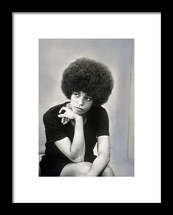 Angela Davis - Activist Framed Print featuring the photograph Portrait Of Angela Davis by Hulton Archive