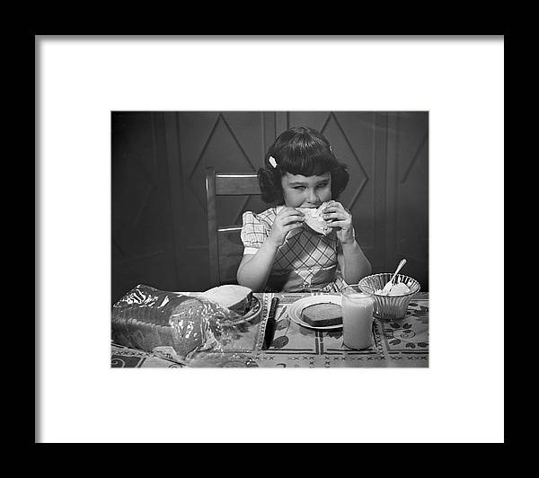 Milk Framed Print featuring the photograph Portrait Of Little Girl Eating Buttered by George Marks