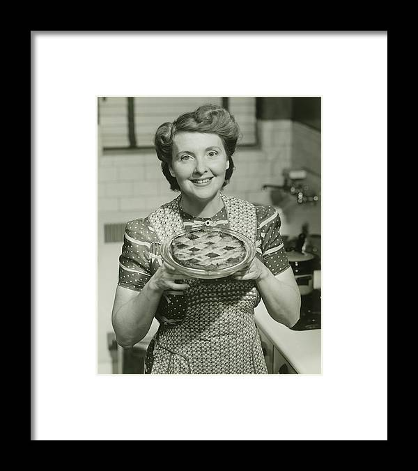 Mature Adult Framed Print featuring the photograph Portrait Of Mature Woman Holding Pie by George Marks