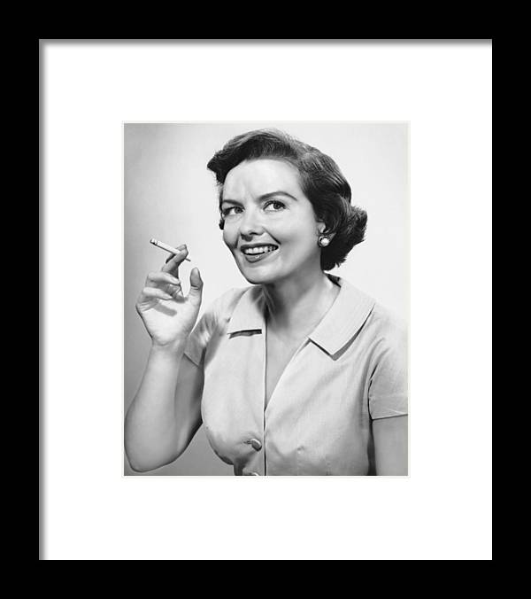 Smoking Framed Print featuring the photograph Portrait Of Woman Holding Cigarettte by George Marks
