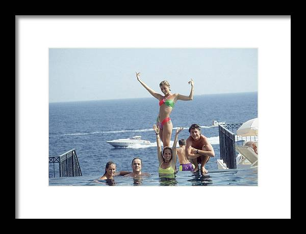 Young Men Framed Print featuring the photograph Posing At Cap Ferrat by Slim Aarons