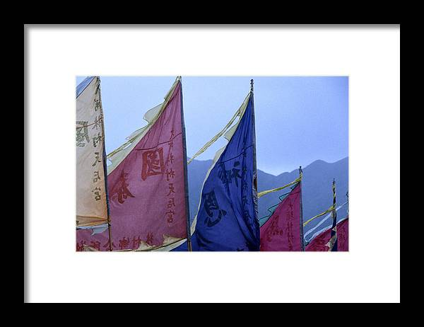 Chinese Culture Framed Print featuring the photograph Prayer Flags To The Sea Goddess Blow In by Lonely Planet