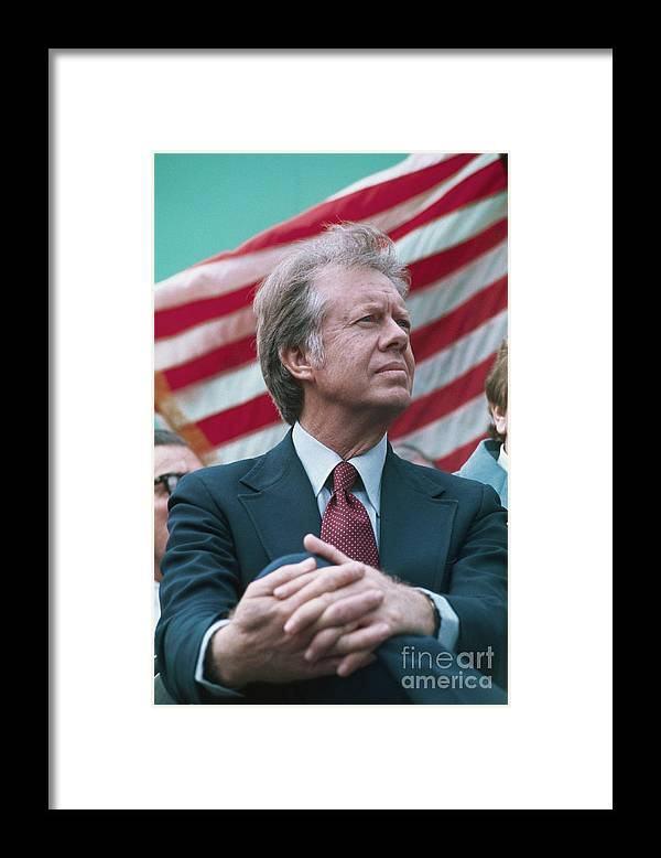 Mature Adult Framed Print featuring the photograph President Jimmy Carter Seated by Bettmann