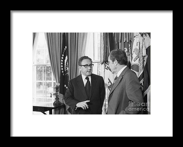 Mature Adult Framed Print featuring the photograph President Nixon And Henry A. Kissinger by Bettmann