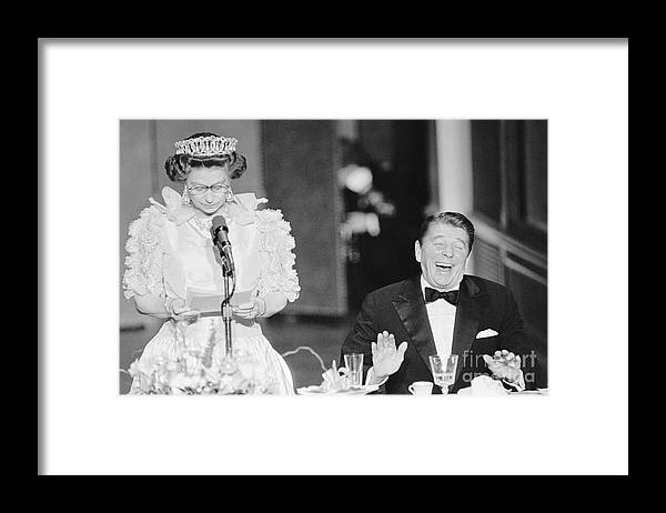 Following Framed Print featuring the photograph President Reagan Laughing At Queens by Bettmann