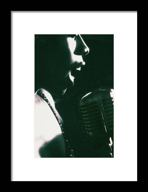 Singer Framed Print featuring the photograph Profile Of Woman Singing Into Microphone by Digital Vision.