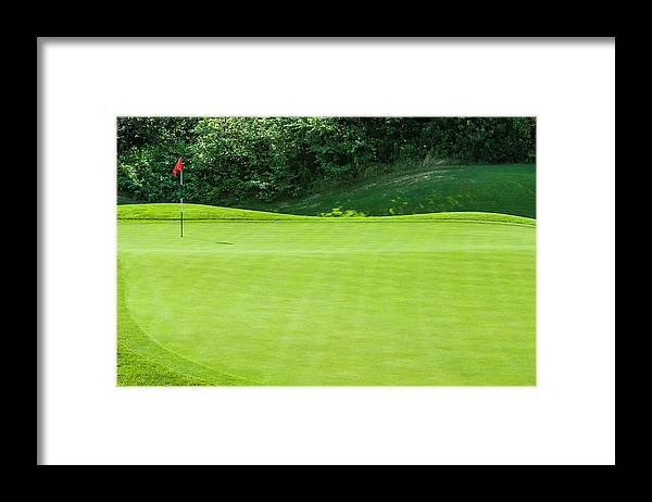 The End Framed Print featuring the photograph Putting Green And Flag At A Golf Course by Stuart Dee