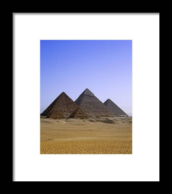 Clear Sky Framed Print featuring the photograph Pyramids In Desert Landscape, Close Up by Stephen Studd