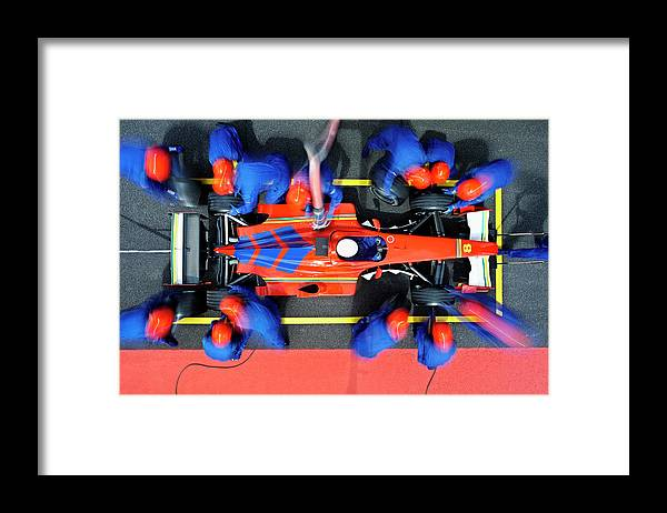 Viewpoint Framed Print featuring the photograph Racecar Driver At The Pit Stop by Fuse