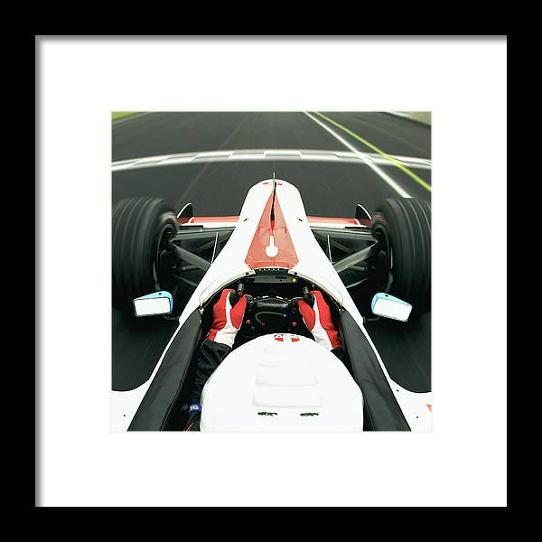 Aerodynamic Framed Print featuring the photograph Racing Driver Approaching Finishing by Alan Thornton