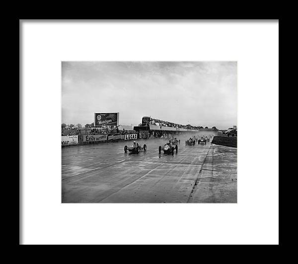 1950-1959 Framed Print featuring the photograph Racing In The Rain by Central Press