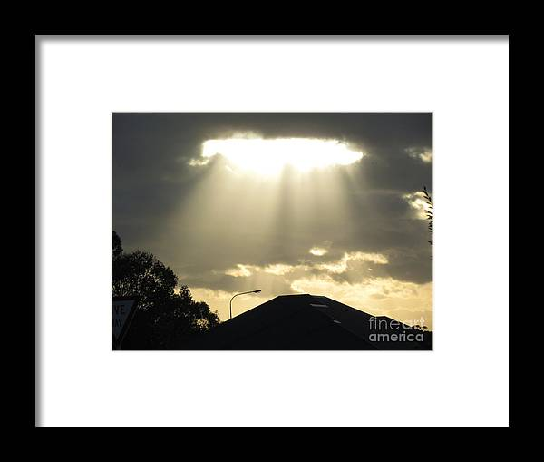 .sun Shinning Through The Rain Clouds . Framed Print featuring the photograph Rain clouds by Joyce Woodhouse