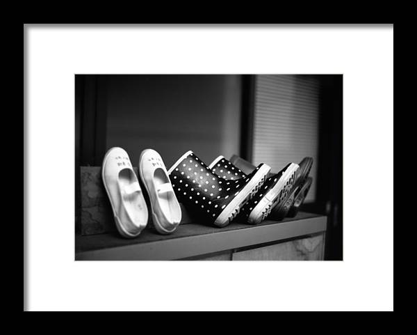 In A Row Framed Print featuring the photograph Rain Shoes by Snap Shooter Jp