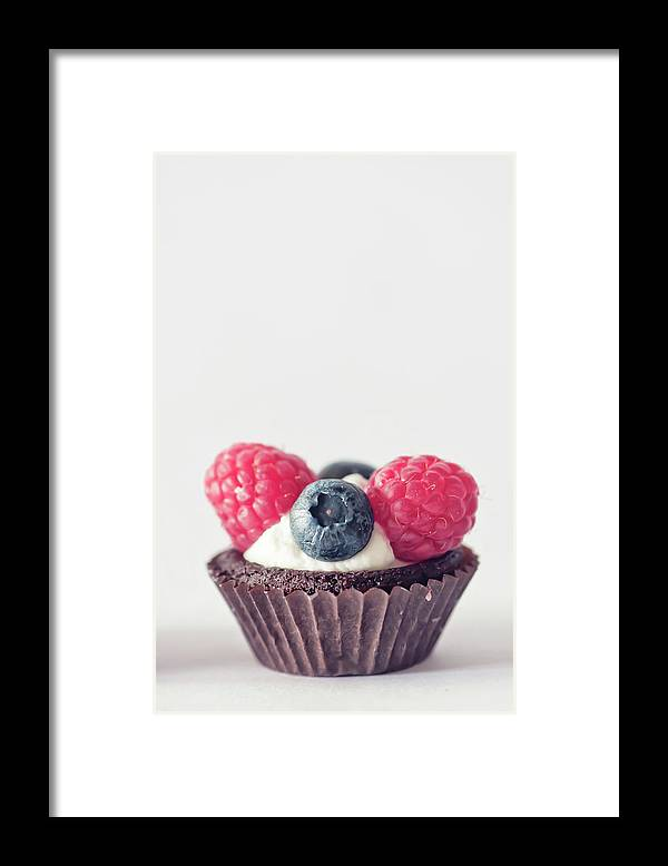 Unhealthy Eating Framed Print featuring the photograph Raspberries And Blueberries Cupcake by Marta Nardini