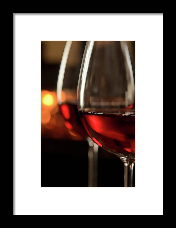 Orange Color Framed Print featuring the photograph Red Wine By The Fire by Nightanddayimages