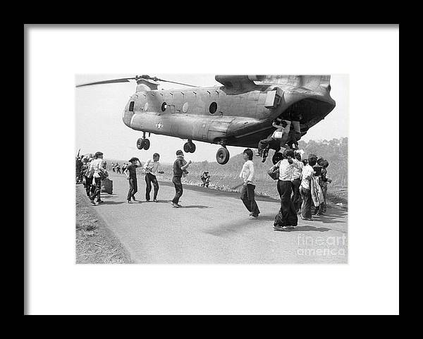 Following Framed Print featuring the photograph Refugees Hanging On To A Supply by Bettmann