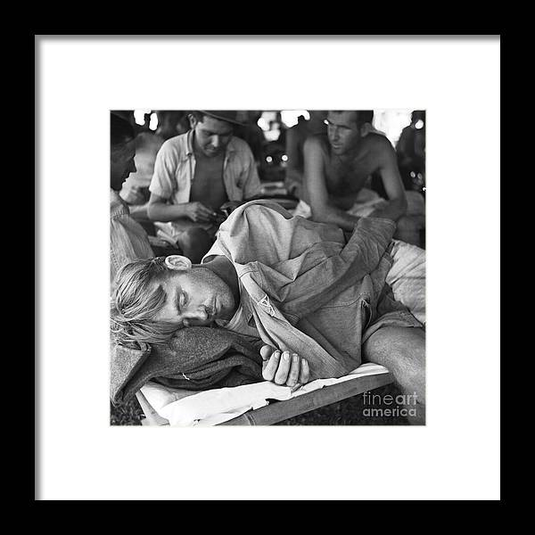 Tranquility Framed Print featuring the photograph Rescued American Pow Sleeping On Cot by Bettmann