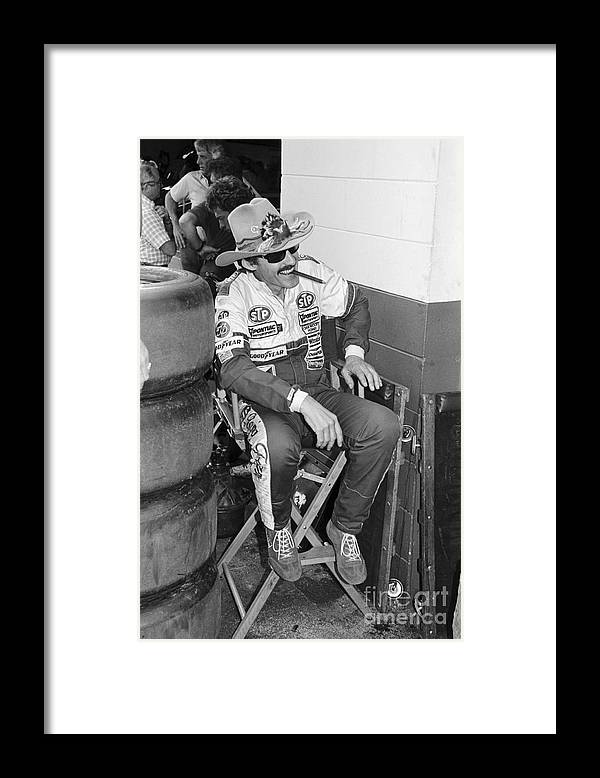 1980-1989 Framed Print featuring the photograph Richard Petty Sitting In Directors Chair by Bettmann