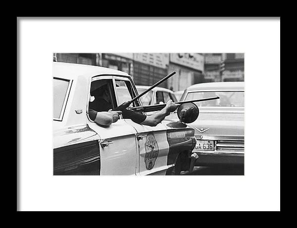 Rifle Framed Print featuring the photograph Riding Shotgun During Newark Riots, 1967 by Fred W. McDarrah