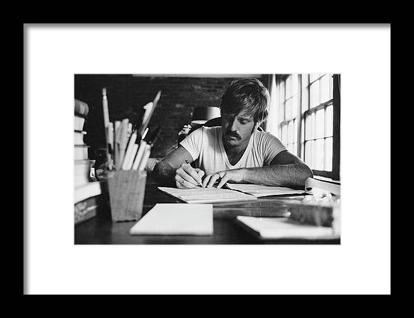 Timeincown Framed Print featuring the photograph Robert Redford Writing At Desk by John Dominis
