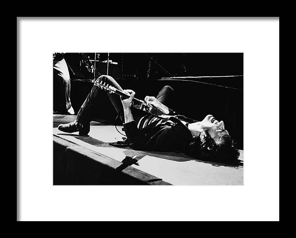 Bruce Springsteen Framed Print featuring the photograph Rock Singer Bruce Springsteen In Concert by George Rose