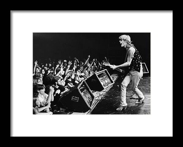 Rock Music Framed Print featuring the photograph Rock Singer Tom Petty In Concert by George Rose