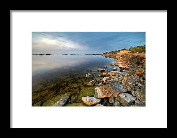Water's Edge Framed Print featuring the photograph Rocks On Shore Line by David Olsson