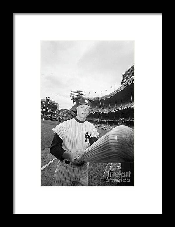 People Framed Print featuring the photograph Roger Maris And His Bat, 1961 by Bettmann