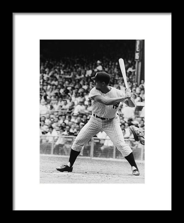 American League Baseball Framed Print featuring the photograph Roger Maris At Bat At Yankee Stadium by Hulton Archive