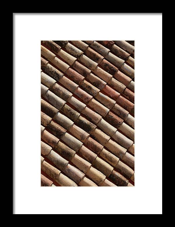 In A Row Framed Print featuring the photograph Rooftop In Dubrovnik Old Town by Martin Child
