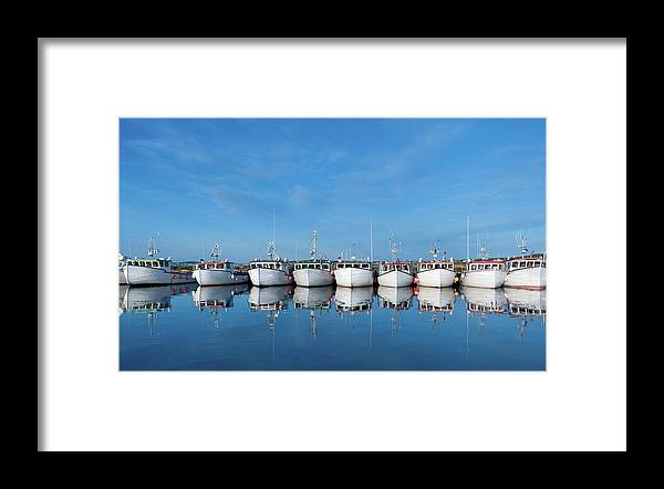 Iles De La Madeleine Framed Print featuring the photograph Row Of Boats With Reflection by Pndtphoto