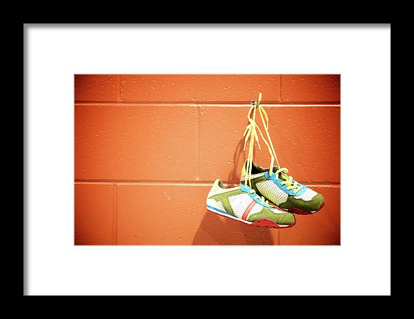 Hanging Framed Print featuring the photograph Runnig Shoes Hanging On A Hook by Pascalgenest