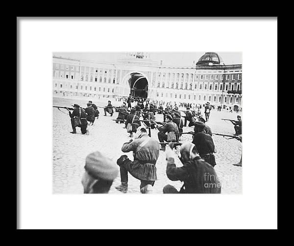 Rifle Framed Print featuring the photograph Russian Soldiers Firing Rifles by Bettmann