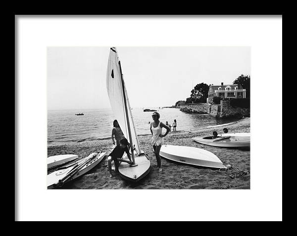 Child Framed Print featuring the photograph Sailboat by Slim Aarons