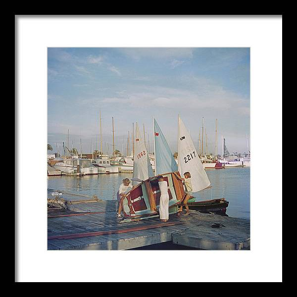 Child Framed Print featuring the photograph Sailing Dinghy by Slim Aarons