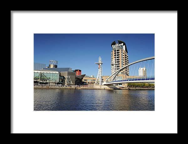 London Millennium Footbridge Framed Print featuring the photograph Salford Quays, Manchester by Chrishepburn