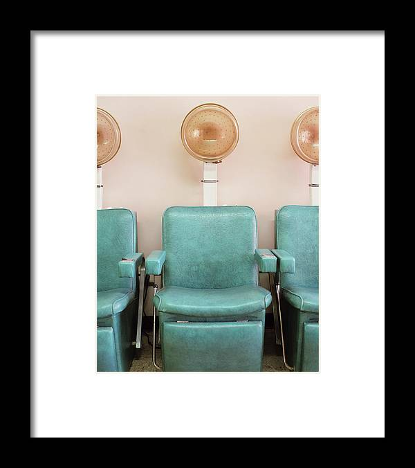 In A Row Framed Print featuring the photograph Salon Hair Dryers by Lisa Romerein