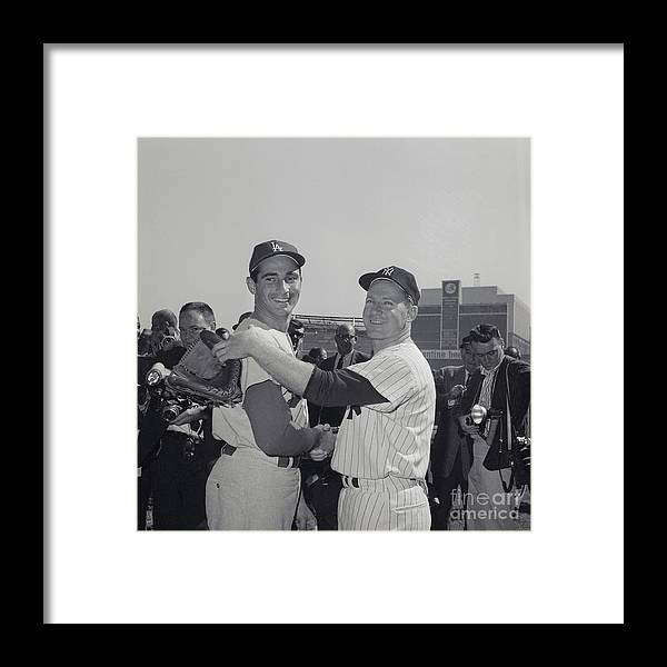 Sandy Koufax Framed Print featuring the photograph Sandy Koufax And Whitey Ford Shaking by Bettmann