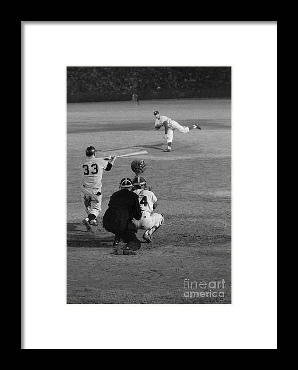 Sandy Koufax Framed Print featuring the photograph Sandy Koufax Striking Jack Sanford by Bettmann