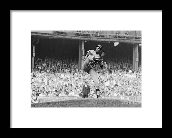 Sandy Koufax Framed Print featuring the photograph Sandy Koufax Throwing Pitch In World by Bettmann