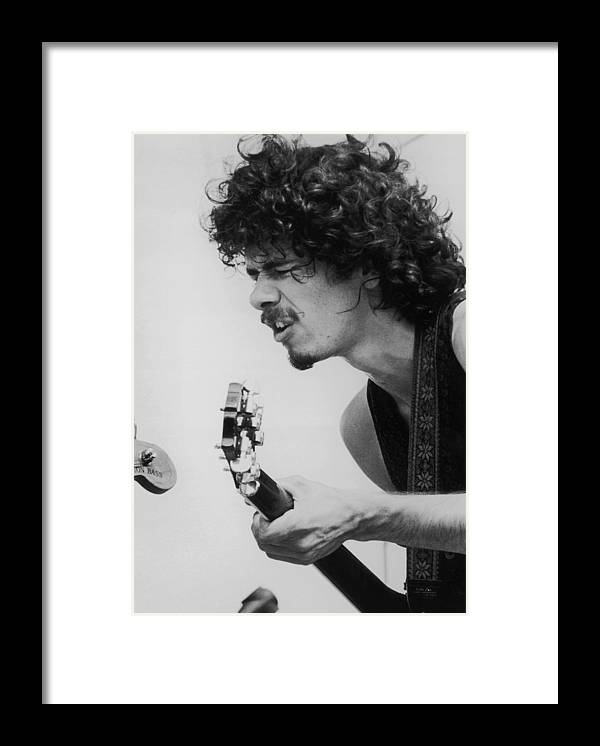 People Framed Print featuring the photograph Santana At Woodstock by Hulton Archive
