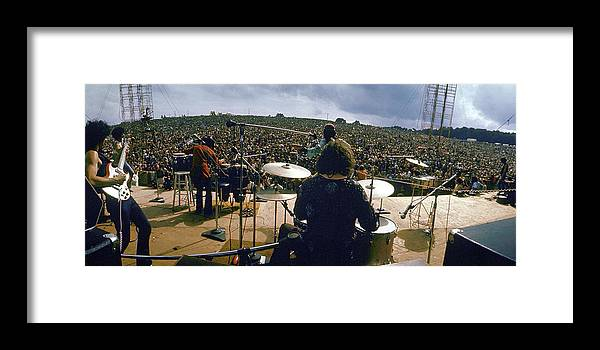 Timeincown Framed Print featuring the photograph Santana Onstage At Woodstock by Bill Eppridge