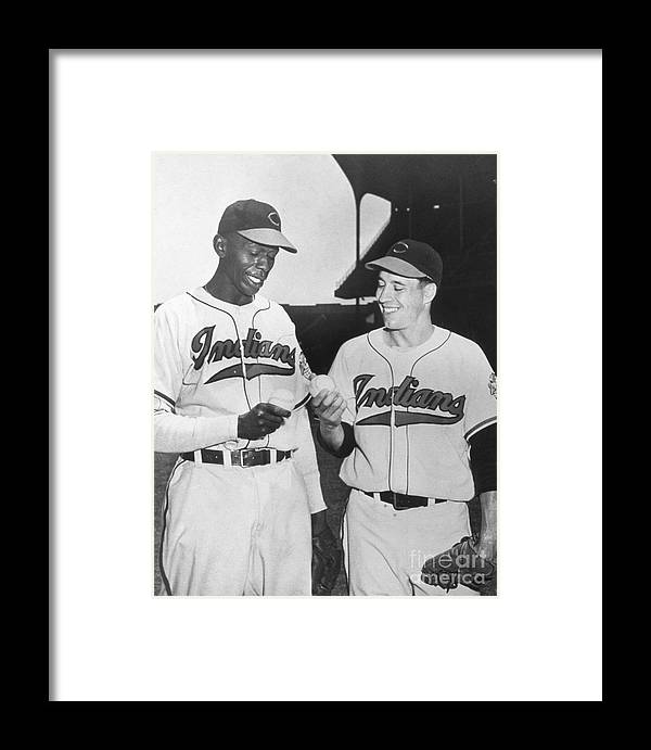 American League Baseball Framed Print featuring the photograph Satchel Paige Bob Feller Comparing by Transcendental Graphics