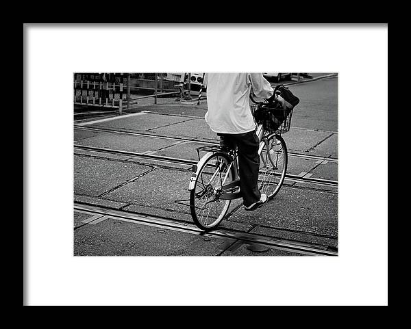 Child Framed Print featuring the photograph Schoolboy Bicycling Across Railroad by Hedgy Nathan Wright